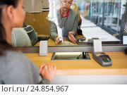 Купить «clerk with cash money and customer at bank office», фото № 24854967, снято 8 сентября 2016 г. (c) Syda Productions / Фотобанк Лори