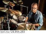 Купить «male musician playing drums and cymbals at concert», фото № 24855283, снято 18 августа 2016 г. (c) Syda Productions / Фотобанк Лори