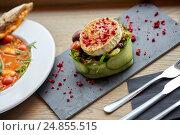 Купить «goat cheese salad with vegetables at restaurant», фото № 24855515, снято 22 сентября 2016 г. (c) Syda Productions / Фотобанк Лори
