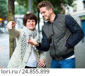 Купить «man points the direction», фото № 24855899, снято 25 октября 2016 г. (c) Яков Филимонов / Фотобанк Лори