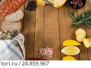 Купить «Gouda cheese, sweet lime, meat, bread slices, black pepper and rosemary on wooden board», фото № 24859967, снято 16 сентября 2016 г. (c) Wavebreak Media / Фотобанк Лори
