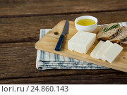 Купить «Gouda cheese, brown bread slices and lime juice with knife on chopping board», фото № 24860143, снято 16 сентября 2016 г. (c) Wavebreak Media / Фотобанк Лори