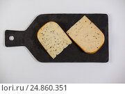 Купить «Dutch gouda cheese on chopping board», фото № 24860351, снято 16 сентября 2016 г. (c) Wavebreak Media / Фотобанк Лори