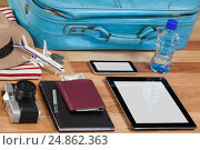 Купить «Holiday and tourism conceptual image with travel accessories», фото № 24862363, снято 16 августа 2016 г. (c) Wavebreak Media / Фотобанк Лори