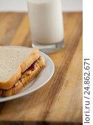 Купить «Peanut butter and jam sandwich on plate», фото № 24862671, снято 20 сентября 2016 г. (c) Wavebreak Media / Фотобанк Лори