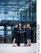 Купить «Businesspeople having a discussion in office premises», фото № 24863459, снято 6 июля 2016 г. (c) Wavebreak Media / Фотобанк Лори