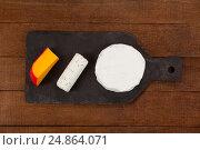 Купить «Brie cheese, goat cheese and gouda cheese on slate board», фото № 24864071, снято 16 сентября 2016 г. (c) Wavebreak Media / Фотобанк Лори