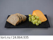 Купить «Gouda cheese, grapes and brown bread slices on slate plate», фото № 24864935, снято 16 сентября 2016 г. (c) Wavebreak Media / Фотобанк Лори