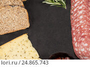 Купить «Brown bread, dutch gouda cheese and meat on slate board», фото № 24865743, снято 16 сентября 2016 г. (c) Wavebreak Media / Фотобанк Лори