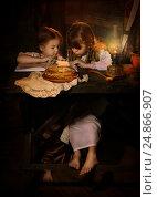 Купить «Девочки читают книгу за столом», фото № 24866907, снято 25 февраля 2016 г. (c) Марина Володько / Фотобанк Лори