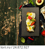 Купить «Fried egg sandwich: quail eggs, avocado and cheese on whole wheat bread», фото № 24872927, снято 16 декабря 2016 г. (c) Наталия Кленова / Фотобанк Лори