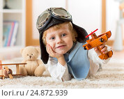 Купить «happy child toddler playing with toy airplane and dreaming of becoming a pilot», фото № 24872939, снято 17 декабря 2016 г. (c) Оксана Кузьмина / Фотобанк Лори