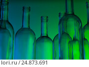 Купить «Group of clear glass wine bottles in green light», фото № 24873691, снято 5 января 2016 г. (c) Сергей Новиков / Фотобанк Лори