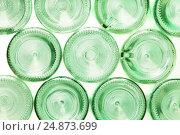 Купить «Bottoms of empty glass bottles isolated on white», фото № 24873699, снято 5 января 2016 г. (c) Сергей Новиков / Фотобанк Лори
