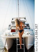Купить «Beautiful bikini woman down the stairs on white yacht», фото № 24884387, снято 1 августа 2016 г. (c) katalinks / Фотобанк Лори