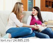 Купить «happy girls talking on sofa in home», фото № 24885235, снято 7 марта 2014 г. (c) Яков Филимонов / Фотобанк Лори