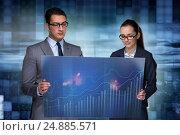 Купить «Business people discussing stock chart trends», фото № 24885571, снято 24 октября 2016 г. (c) Elnur / Фотобанк Лори