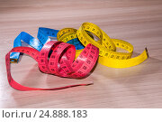 Купить «Blue, red and yellow centimeter on the table», фото № 24888183, снято 28 декабря 2016 г. (c) Катерина Белякина / Фотобанк Лори
