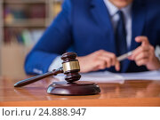 Handsome judge with gavel sitting in courtroom. Стоковое фото, фотограф Elnur / Фотобанк Лори