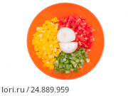 Shredded bell pepper and onion in bowl isolated on white. Three colors of vegetables. Colorful food. Стоковое фото, фотограф Евгений Пидеркин / Фотобанк Лори