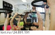 Купить «Beautiful women exercising in fitness studio», видеоролик № 24891191, снято 29 мая 2020 г. (c) Wavebreak Media / Фотобанк Лори