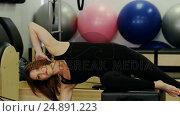Купить «Beautiful woman exercising in fitness studio», видеоролик № 24891223, снято 9 апреля 2020 г. (c) Wavebreak Media / Фотобанк Лори