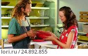 Купить «Workers discussing over food items at the counter», видеоролик № 24892855, снято 14 декабря 2019 г. (c) Wavebreak Media / Фотобанк Лори
