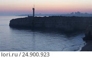 Купить «Sea coast sunset landscape and lighthouse», видеоролик № 24900923, снято 16 января 2017 г. (c) Юрий Брыкайло / Фотобанк Лори