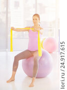 Купить «Woman sitting on exercise ball», фото № 24917615, снято 8 декабря 2019 г. (c) Wavebreak Media / Фотобанк Лори