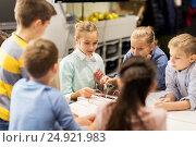 Купить «happy children building robots at robotics school», фото № 24921983, снято 23 октября 2016 г. (c) Syda Productions / Фотобанк Лори