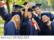 students or bachelors taking selfie by smartphone. Стоковое фото, фотограф Syda Productions / Фотобанк Лори