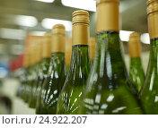 Купить «close up of bottles at liquor store», фото № 24922207, снято 2 ноября 2016 г. (c) Syda Productions / Фотобанк Лори