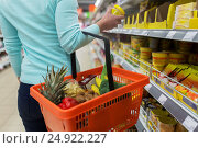Купить «woman with food basket and jar at grocery store», фото № 24922227, снято 2 ноября 2016 г. (c) Syda Productions / Фотобанк Лори
