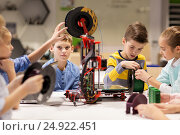 Купить «happy children with 3d printer at robotics school», фото № 24922451, снято 23 октября 2016 г. (c) Syda Productions / Фотобанк Лори