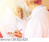 Купить «senior woman and doctor with clipboard at hospital», фото № 24922623, снято 11 июня 2015 г. (c) Syda Productions / Фотобанк Лори