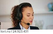 Купить «girl answering call in office», видеоролик № 24923431, снято 1 октября 2016 г. (c) Яков Филимонов / Фотобанк Лори