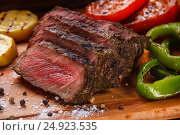 Juicy steak and grilled vegetables with spices. Стоковое фото, фотограф Ольга Соловьева / Фотобанк Лори