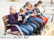Купить «children with mobile devices», фото № 24931407, снято 12 мая 2019 г. (c) Яков Филимонов / Фотобанк Лори