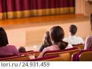Купить «Positive audience expecting movie to begin», фото № 24931459, снято 3 декабря 2016 г. (c) Яков Филимонов / Фотобанк Лори