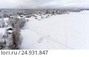 Купить «Следы на льду озера, ведущие к берегу с небольшой деревней», фото № 24931847, снято 2 января 2017 г. (c) Кекяляйнен Андрей / Фотобанк Лори