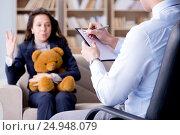 Купить «Woman with bear toy during psychologist visit», фото № 24948079, снято 7 декабря 2016 г. (c) Elnur / Фотобанк Лори