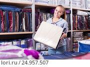 Купить «Woman customer choosing for beautiful bed linen», фото № 24957507, снято 21 января 2020 г. (c) Яков Филимонов / Фотобанк Лори