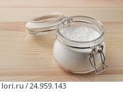 Купить «Open glass jar of baking soda», фото № 24959143, снято 27 декабря 2016 г. (c) Антон Стариков / Фотобанк Лори