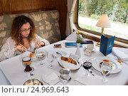 Купить «Peru Luxury train from Cuzco to Machu Picchu. Orient Express. Belmond. The waiters serve delicacies inside the Hiram Bingham Orient Express which runs...», фото № 24969643, снято 18 октября 2016 г. (c) age Fotostock / Фотобанк Лори