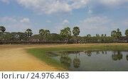 Купить «Angkor Wat temple in Siem Reap, Cambodia», видеоролик № 24976463, снято 7 декабря 2016 г. (c) Михаил Коханчиков / Фотобанк Лори
