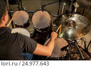 Купить «male musician playing drums and cymbals at concert», фото № 24977643, снято 18 августа 2016 г. (c) Syda Productions / Фотобанк Лори
