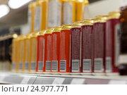 Купить «close up of beer or cider cans at liquor store», фото № 24977771, снято 2 ноября 2016 г. (c) Syda Productions / Фотобанк Лори