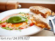Купить «plate of delicious gazpacho soup at restaurant», фото № 24978027, снято 22 сентября 2016 г. (c) Syda Productions / Фотобанк Лори