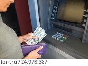 Купить «close up of hand withdrawing money at atm machine», фото № 24978387, снято 8 сентября 2016 г. (c) Syda Productions / Фотобанк Лори