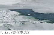 Купить «Cracked ice floating on the river in spring time», видеоролик № 24979335, снято 13 мая 2016 г. (c) Михаил Коханчиков / Фотобанк Лори